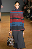 Nyasha Matonhodze walks runway in an outfit from the Marc by Marc Jacobs Fall/Winter 2011 collection, during New York Fashion Week, Fall 2011.