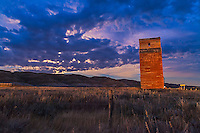 The old grain elevator at Dorothy, Alberta under the Full Harvest Moon in cloud, and illuminated by passing car headlights. Taken as part of a 400-frame time-lapse sequence. With Canon 5D MkII and 16-35mm lens. Exposure with Little Bramper intervalometer.