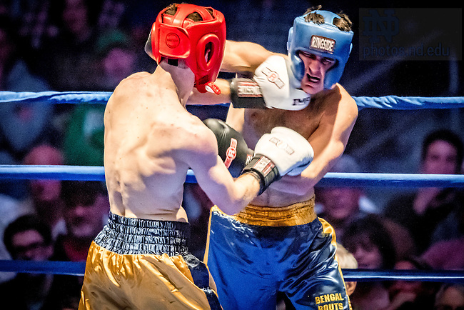 "March 3, 2017; Jack ""Not the Guy from Lost"" Shepard (gold trunks) lands a punch on senior captain Jack ""Hammer"" Corrigan (blue trunks) in the 174lb. division. Shepard won in a unanimous decision. (Photo by Matt Cashore/University of Notre Dame)"