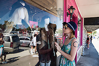 Window shopping is a favorite activity for Austin locals and tourist alike. South Congress is Austin's most eclectic and popular spot for unique shopping Austin's treasures - Stock Image.