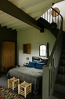 The guest bedroom is situated in the old pigeonnie which has a staircase leading to a bathroom in the attic