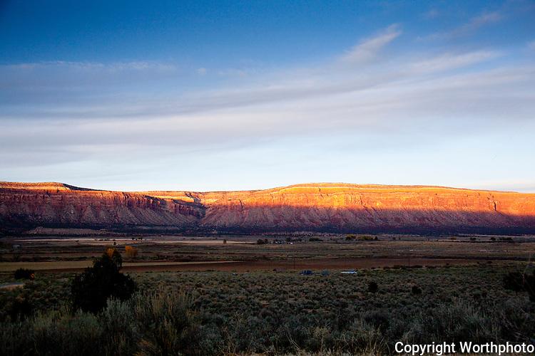 Sunset bathes the cliffs over Paradox Valley, Colorado
