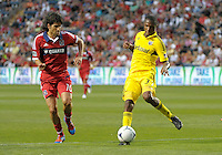 Columbus defender Josh Williams (3) clears the ball in front of Chicago midfielder Sebastian Grazzini (10).  The Chicago Fire defeated the Columbus Crew 2-1 at Toyota Park in Bridgeview, IL on June 23, 2012.