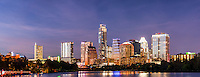 We captured this panorama skyline of the city of Austin at night from along the Ladybird Lake hike and bike trail.   We thought the skyline with the high rise building were brilliant against the night sky with the Frost, Austonian, Four Season Hotel, Austin 360 and the W along with many others all crowding together along the shoreline.   You can see the reflection of the skyline in Ladybird lake but come back in a year or two and it will likely be different. The city skyline has been changing very fast over the last four or five years as new construction is popping up with high rise buildings almost every six or seven months in this town.