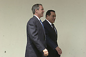 United States President George W. Bush walks President Hosni Mubarak of Egypt down the Colonnade from the Oval Office to the Residence at the White House following their meeting in the Oval Office on Monday, April 2, 2001..Credit: Ron Sachs / CNP