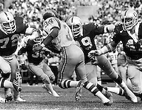 Raider's defense,  John Matusak, Willie Hall and Phil Villapiano, 1977. Copyright Ron Riesterer