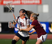 Anne Thomas (21) of Virginia fights for the ball with Libby Rosebro (24) of Virginia Tech during the first round of the ACC Women's Lacrosse Championship in College Park, MD.  Virginia defeated Virginia Tech, 18-6.