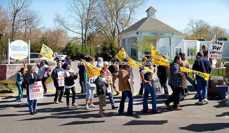 WINSTED, CT. 15 April 2010-041510SV07--1199 workers protest at Laurel Hill Healthcare in Winsted Thursday. Nursing home workers at Laurel Hill Healthcare in Winsted went on strike at 6 a.m. to protest being without a contract for more than a year. Laurel Hill is one of four nursing homes in CT owned by Vernon-based Spectrum Healthcare where workers were striking. Steven Valenti Republican-American