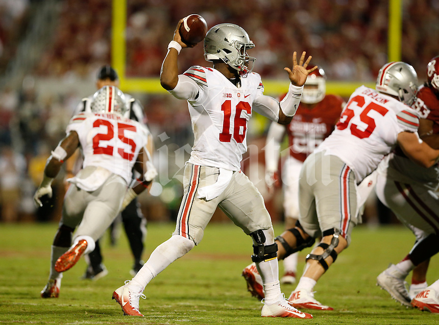 Ohio State Buckeyes quarterback J.T. Barrett (16) looks for an open man during Saturday's NCCAA Division I football game against the Oklahoma Sooners at Gaylord Family - Oklahoma Memorial Stadium in Norman, Ok., on September 17, 2016. (Barbara J. Perenic/The Columbus Dispatch)