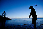 Justin Pulliam throws a hook to catch to collect crayfish traps in Lake Tahoe near Incline Village, Nevada, July 8, 2012. The Jacksons are the first to commercially harvest crayfish in Lake Tahoe.