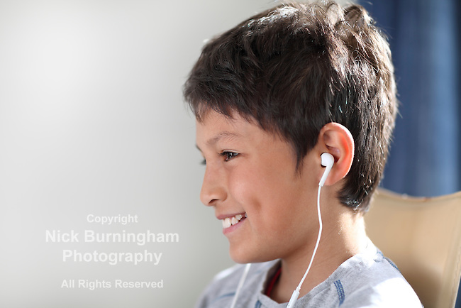 Young boy with headphones watching computer - shallow depth of field