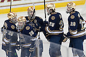 Steven Fogarty (ND - 26), Peter Schneider (ND - 15), Jeff Costello (ND - 11), Kevin Lind (ND - 25) and Stephen Johns (ND - 28) celebrate a goal. - The visiting University of Notre Dame Fighting Irish defeated the Boston College Eagles 7-2 on Friday, March 14, 2014, in the first game of their Hockey East quarterfinals matchup at Kelley Rink in Conte Forum in Chestnut Hill, Massachusetts.