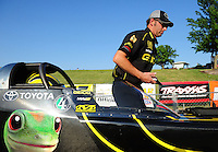 May 18, 2012; Topeka, KS, USA: NHRA Aaron Brooks crew chief for top fuel dragster driver Morgan Lucas during qualifying for the Summer Nationals at Heartland Park Topeka. Mandatory Credit: Mark J. Rebilas-
