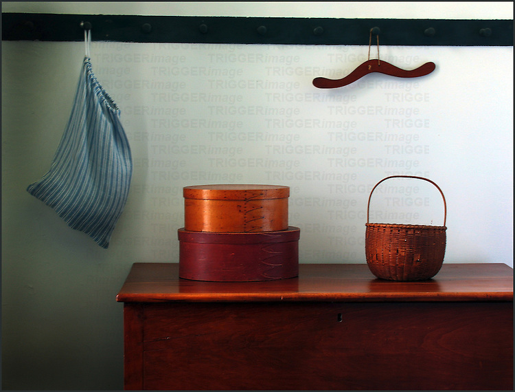 Shaker style hat boxes a basket and coat hanger