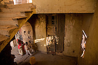 Kids play in the ruined stairwell of State House IDP camp in Hargeysa, Somaliland. .The building was built in 1952 in anticipation of a visit by Queen Elizabeth ll. It was home of the  Governor of the Protectorate who entertained in the gardens. .Now it is home to 29,000 people-all displaced by war.