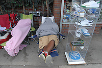 "FOR YEEZY: A couple of the two dozen people camped in front of Walter's shoe store in downtown Atlanta. They are hoping to buy the $215 limited edition Kanya West-designed ""Air Yeezy"" shoes that go on sale this Saturday."