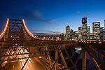 Dusk view over the Story Bridge toward the riverside business district of Brisbane.   Brisbane, Queensland, AUSTRALIA