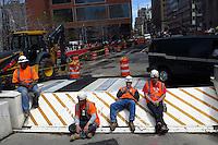 New York, USA. 1st May 2014.  Workers take a break during their work in Lower Manhattan. Eduardo MunozAlvarez/VIEWpress