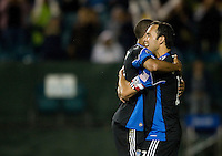 Ramiro Corrales of Earthquakes hugs Ryan Johnson after Wondolowski scored a goal during the second half of the game against Red Bull at Buck Shaw Stadium in Santa Clara, California.  San Jose Earthquakes defeated New York Red Bulls, 4-0.