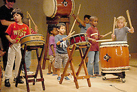 Children play the drums with members of  the Los Angeles Taiko Center at the Santa Monica Library on Monday, July 18, 2011..