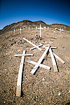 Historic early 1900s cemetery with a pile of crosses on the group, Goldfield, Nev.