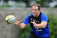 Henry Thomas of Bath Rugby receives the ball. Bath Rugby training session on August 4, 2015 at Farleigh House in Bath, England. Photo by: Patrick Khachfe / Onside Images