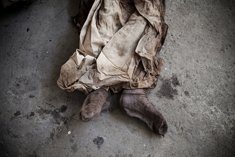 """Exhumation of bodies of the """"disappeared,"""" or """"XX"""" - Sin Nombre - from the civil war, at one of Guatemala's mass graves, at La Verbena Cementary, in Guatemala City, on Tuesday, Nov. 8, 2011. During Guatemala's 36-year civil war, about 200,00 people were killed and another 50,000 disappeared and buried in mass graves throughout the country. 93% of human rights abuses were attributed to the military. Today, young forensic anthropologists exhume bodies and unearth their country's violent past."""