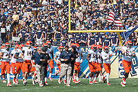 Head Coach Mike London (center) leads his Virginia team onto the field. The Pitt Panthers defeated the Virginia Cavaliers 14-3 at Heinz Field, Pittsburgh, PA on Saturday, September 28, 2013.