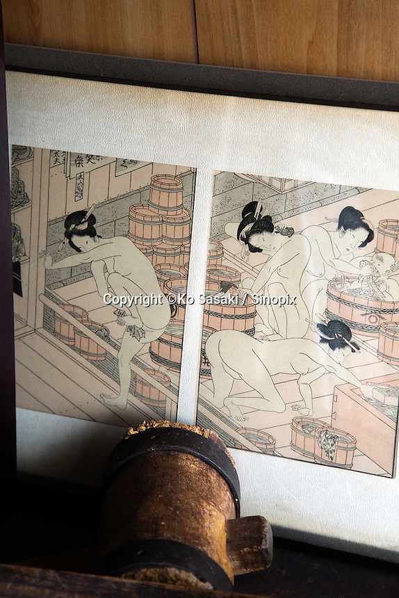 Japanese wood print showing wooden buckets in Japanese public bath at Okeei
