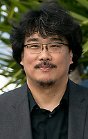 Director Bong Joon-Ho attends the photocall of the movie 'Okja' during the 70th Annual Cannes Film Festival at Palais des Festivals in Cannes, France, on 19 May 2017. - NO WIRE SERVICE · Photo: Hubert Boesl/dpa /MediaPunch ***FOR USA ONLY***
