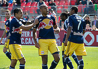 27 April 2013: New York Red Bulls forward Thierry Henry #14 celebrates a goal by New York Red Bulls midfielder Tim Cahill #17 during the second half in an MLS game between the New York Red Bulls and Toronto FC at BMO Field in Toronto, Ontario Canada..The New York Red Bulls won 2-1....