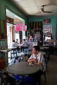 A man sits with a cup of coffee at a local kopitiam (traditional Chinese breakfast and coffee shop) in capital Georgetown of Penang in Malaysia. Photo: Sanjit Das/Panos