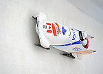 15 December 2007: Canada 1 pilot Pierre Lueders with brakeman Lascelles Brown enter turn 17 during their second run at the FIBT World Cup Bobsled Competition at the Olympic Sports Complex on Mount Van Hoevenberg, at Lake Placid, New York, USA. Canada 1 came in first to take the Gold Medal...Mandatory Photo Credit: Ed Wolfstein Photo