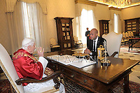 Pope Benedict XVI receives  President of Haiti Michel Martellyat the end of a private audience in his private library at the Vatican on November 22, 2012