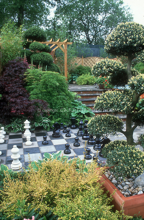 Tiered Backyard Pictures : Big backyard chess set in garden  Plant & Flower Stock Photography