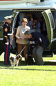 "Washington, DC - September 16, 2001 -- United States President George W. Bush helps his dog, Barney from Marine 1 as First Lady Laura Bush looks on as he returns from a week-end at Camp David on Sunday, September 16, 2001.  In his remarks to the press as walked to the White House,  President Bush warned ""We need to be alert to the fact that these evil-doers still exist""  and urged Americans to not let terrorism distract them from their normal routines..Credit: Ron Sachs / CNP"