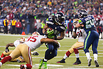 Seattle Seahawks running back Marshawn Lynch (24) rushes against the San Francisco 49ers safety Eric Reed (35) during the NFL  Championship Game at CenturyLink Field in Seattle, Washington on January 19, 2014.  Lynch rushed for 109 yards and scored one touchdown in the Seahawks 23-17 win over the 49ers. The Seahawks will represent the NFC in the Super Bowl. ©2014. Jim Bryant Photo. ALL RIGHTS RESERVED.