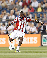 Chivas USA midfielder Shalrie Joseph (18) takes a shot. In a Major League Soccer (MLS) match, the New England Revolution tied Chivas USA, 3-3, at Gillette Stadium on August 29, 2012.