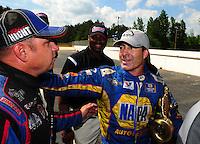 May 6, 2012; Commerce, GA, USA: NHRA funny car driver Robert Hight (left) congratulates Ron Capps after winning the Southern Nationals at Atlanta Dragway. Mandatory Credit: Mark J. Rebilas-