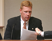 Prosecution rebuttal witness, Scott Riordan, a special agent with the federal Bureau of Alcohol, Tobacco, Firearms and Explosives (ATF), testifies during the trial of sniper suspect John Allen Muhammad at the Virginia Beach Circuit Court in Virginia Beach, Virginia on November 13, 2003.<br /> Credit: Steve Earley - Pool via CNP