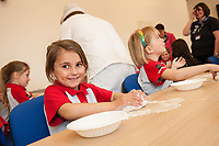 Lilly Wilson (5) gets to grips with some dough