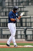 Left fielder Tim Tebow (15) of the Columbia Fireflies claps his hands after hitting a single in a game against the Lexington Legends on Sunday, April 23, 2017, at Spirit Communications Park in Columbia, South Carolina. Lexington won, 4-2. (Tom Priddy/Four Seam Images)