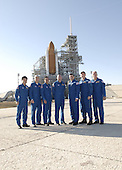 Cape Canaveral, FL - January 20, 2009 -- The STS-119 crew members gather on Launch Pad 39A at NASA's Kennedy Space Center in Florida before beginning their emergency egress training. From left are Mission Specialists Koichi Wakata, Steve Swanson and Joseph Acaba, Pilot Tony Antonelli, Commander Lee Archambault and Mission Specialists Richard Arnold and John Phillips. The astronauts are at Kennedy to prepare for launch as part of the Terminal Countdown Demonstration Test activities. The TCDT includes equipment familiarization and a simulated launch countdown. The crew of space shuttle Discovery is targeted to launch on the STS-119 mission Feb. 12. During Discovery's 14-day mission, the crew will install the S6 truss segment and solar arrays to the starboard side of the International Space Station, completing the station's truss, or backbone. .Credit: Kim Shiflett - NASA via CNP