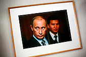 A photograph taken by an unidentified photographer hangs in the office of Kirsan Ilyumzhinov, 44, president of the southern Russian republic Kalmykia. The photograph depicts Ilyumzhinov standing near Russian president Vladimir Putin. ..Ilyumzhinov, who is also the president of the World Chess Federation, Fide, is hosting one of the world?s most important matches in history. ..The match beginning September 21 in Elista, the capital of Europe?s only Buddhist nation, will end a 13-year split in the game that has produced rival claims to the title. ..Veselin Topalov, a Bulgarian ranked first according to Fide, will play against Vladimir Kramnik, who is the Classical Chess World Champion, a title established after Garry Kasparov led a breakaway from Fide in 1993. The two grandmasters, both aged 31, will face each other for the right to be undisputed world chess champion...A Buddhist millionaire businessman, Ilyumzhinov acquired his wealth in the economic free-for-all which followed the collapse of the Soviet Union. ..At the age of just over 30, he was elected president in 1993 after promising voters $100 each and a mobile phone for every shepherd. Soon after, he introduced presidential rule, concentrating power in his own hands. ..He called early elections in 1995 and was re-elected unopposed - this time for a seven-year term. He won re-election in 2002. In line with new legislation on the appointment of regional leaders, Mr Ilyumzhinov tendered his resignation to the Kremlin in October 2005. Putin renominated him and the Kalmyk parliament endorsed the nomination. ..He denies persistent accusations of corruption, human rights abuses and the suppression of media freedom. When Larisa Yudina, editor of the republic's only opposition newspaper and one of his harshest critics, was murdered in 1998, he strenuously rejected allegations of involvement. ..Mr Ilyumzhinov has been president of the International Chess Federation (FIDE) since 1995 and has been enthusiastic about attr