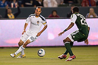 Landon Donovan (10) attempts to navigate around Rodney Wallace (22) of the Portland Timbers. The LA Galaxy defeated the Portland Timbers 3-0 at Home Depot Center stadium in Carson, California on  April  23, 2011....