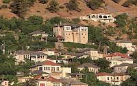 The Zekate House, a grand fortified tower house built 1811-12 with twin towers and a great double arched facade, built and owned by Beqir Zeko, a general administrator of Ali Pasha's government, Gjirokastra, Southern Albania. Gjirokastra was settled by the Greek Chaonians, the Romans and Byzantines before becoming an Ottoman city in 1417. Its old town was listed as a UNESCO World Heritage Site in 2005. Picture by Manuel Cohen