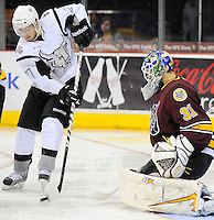 San Antonio Rampage's Greg Rallo, left, sets up a shot in front of Chicago Wolves goaltender Eddie Lack during the second period of an AHL hockey game, Wednesday, April 4, 2012, in San Antonio. (Darren Abate/pressphotointl.com)