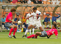 Claudio Reyna battles for the ball. The USA tied South Korea, 1-1, during the FIFA World Cup 2002 in Daegu, Korea.
