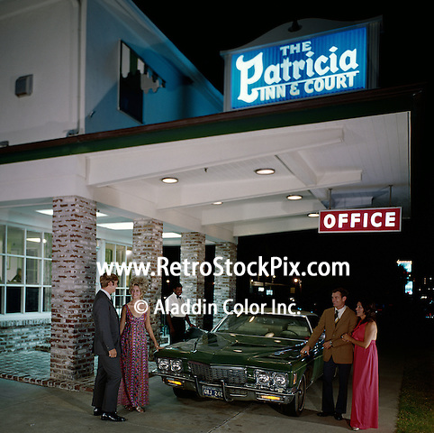 Car and people at entrance of hotel