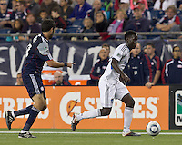 San Jose Earthquakes midfielder Simon Dawkins (10) dribbles down the wing. In a Major League Soccer (MLS) match, the San Jose Earthquakes defeated the New England Revolution, 2-1, at Gillette Stadium on October 8, 2011.